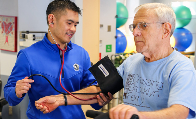 Patient on a treadmill during cardiac rehabilitation session