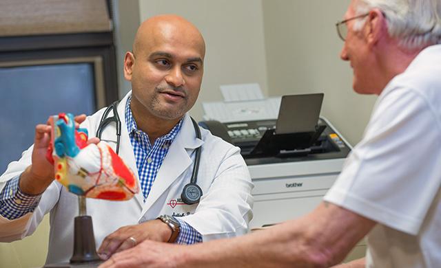 Dr. Satish Tiyyagura and patient