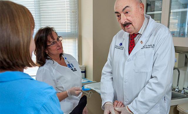 Dr. Coiroiu and patient
