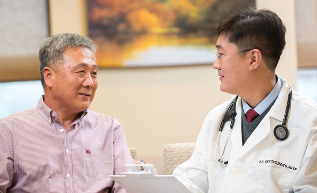 Dr. Cho and patient discuss treating heart disease